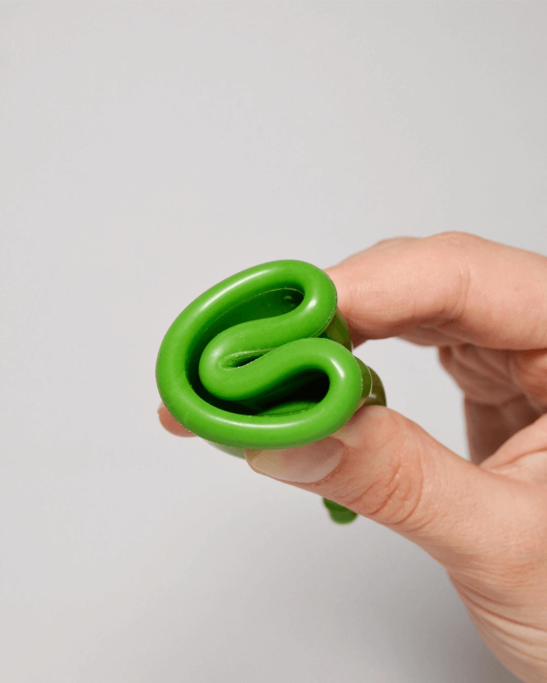 Зеленая менструальная чаша OnlyCup в сложенном виде